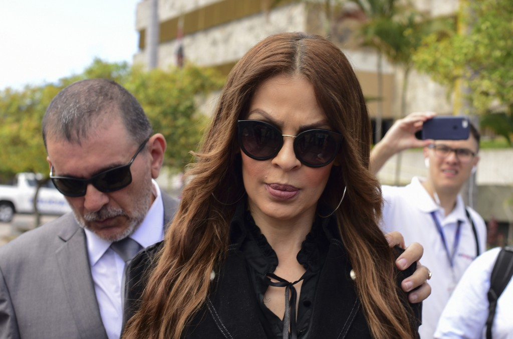 Former Miss Costa Rica 1994, Jazmin Morales, walks after filing a complaint against former President Oscar Arias, in San Jose, Costa Rica, Wednesday,