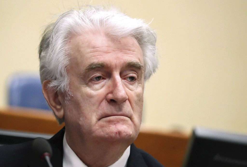 FILE - In this April 24, 2018 file photo, Former Bosnian Serb leader Radovan Karadzic arrives for the second day of his appeal at a U.N. court against
