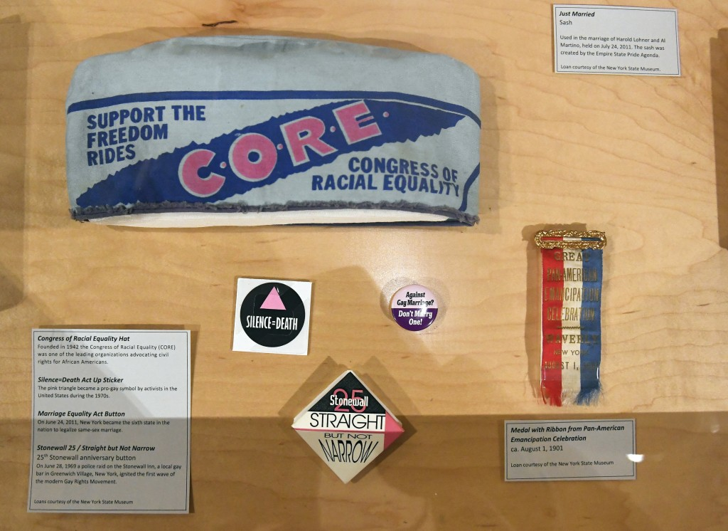 """This Monday, Feb. 11, 2019 photo shows some items on display at the """"People of New York"""" diversity exhibit at the state Capitol in Albany, N.Y. Locate..."""