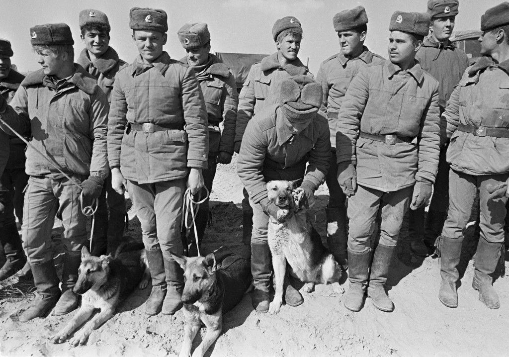 In this photo taken on Feb. 15, 1989, Soviet Army soldiers with their war-dogs line up after their unit crossed a bridge on the border between Afghani...