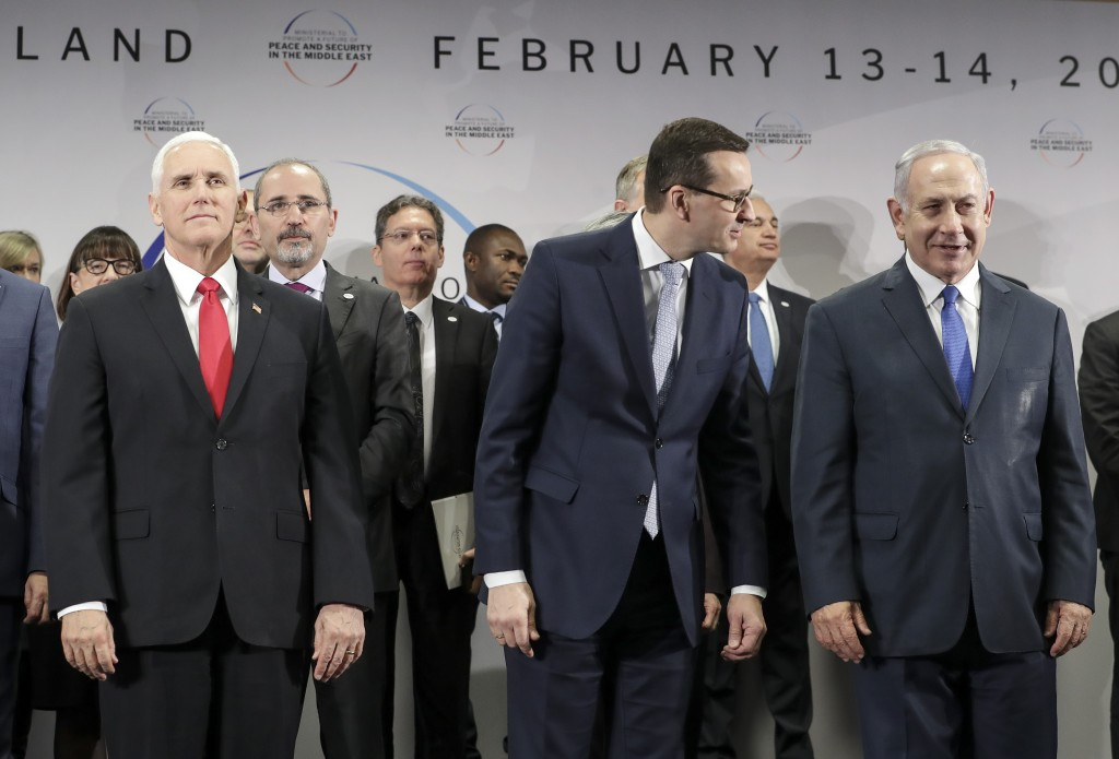 United States Vice President Mike Pence, Prime Minister of Poland Mateusz Morawiecki and Israeli Prime Minister Benjamin Netanyahu, from left, stand o...