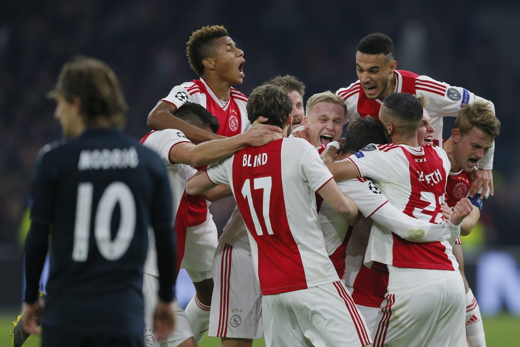 Ajax's Nicolas Tagliafico celebrates with his teammates after scoring his side's opening goal and the goal was disallowed after a review by VAR during...