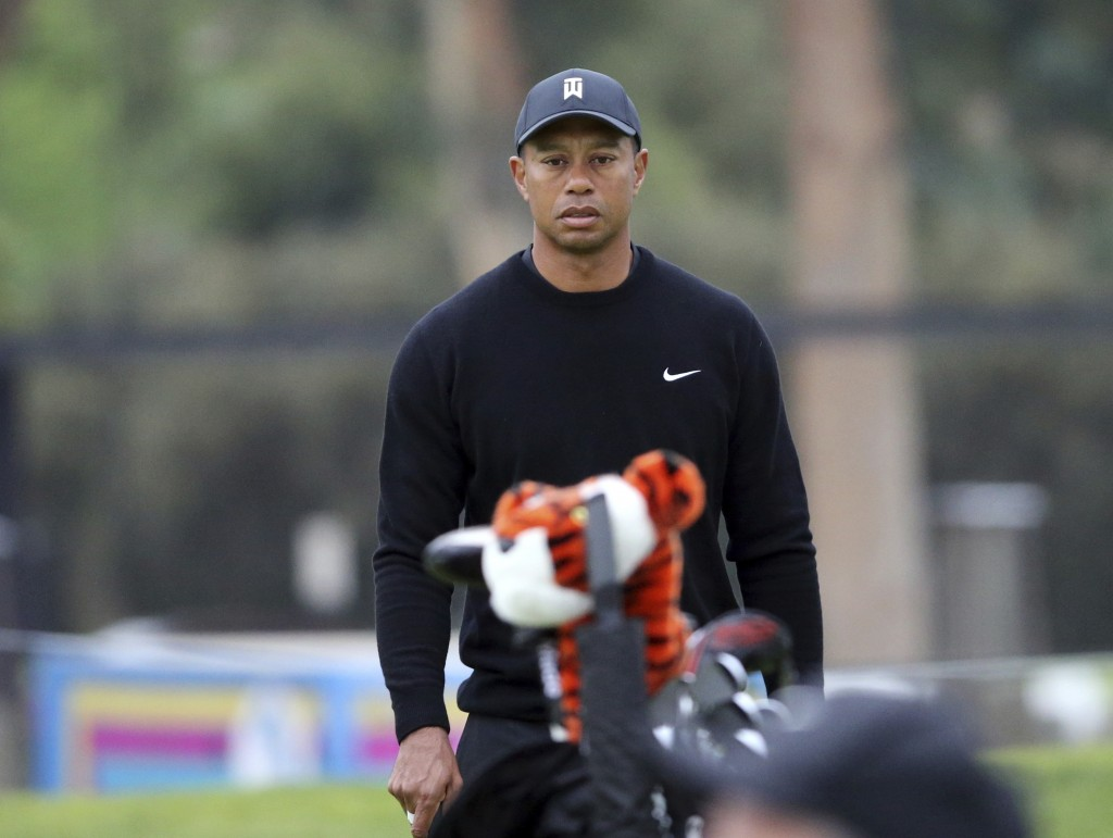 Tiger Woods walks the third green during the pro-am round at the Genesis Open golf tournament at Riviera Country Club in the Pacific Palisades area of...