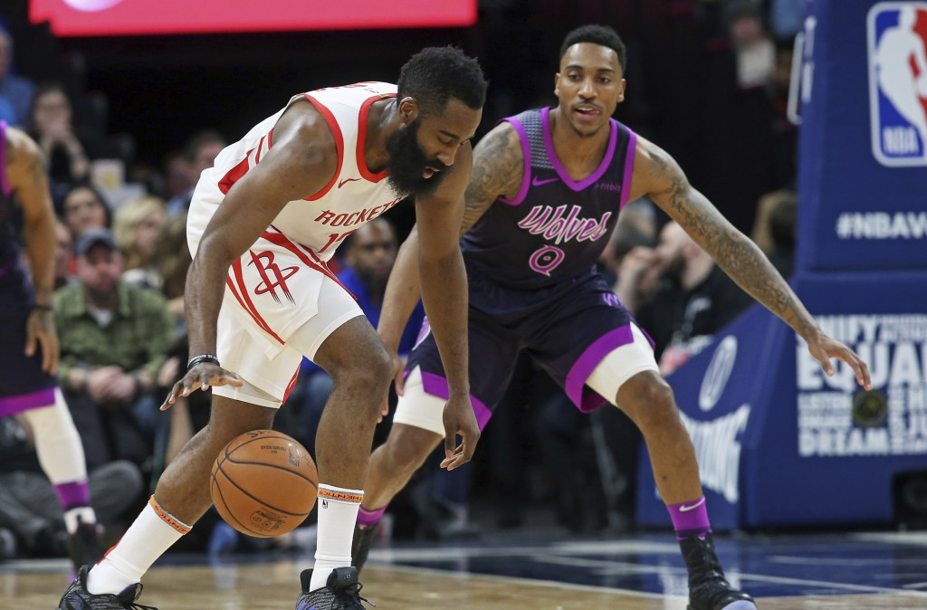 Houston Rockets' James Harden, left, dribbles as Minnesota Timberwolves' Jeff Teague defends in the first half of an NBA basketball game, Wednesday, F