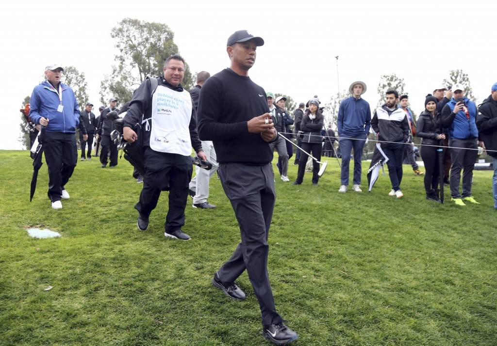 Tiger Woods walks the course in the Pro-Am round of the Genesis Open golf tournament at Riviera Country Club in the Pacific Palisades area of Los Ange...