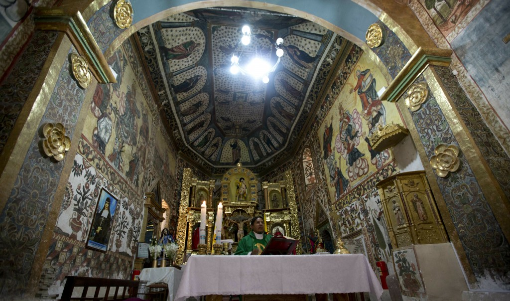 In this Feb. 9, 2019 photo, Father Rafael Choque celebrates Mass in the local church in Curahuara de Carangas, Bolivia. The church's central dome feat