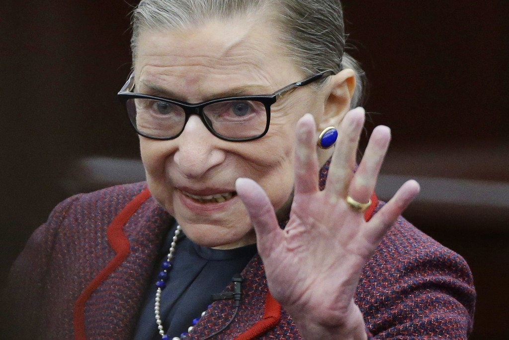 FILe - In this Jan. 30, 2018 file photo Supreme Court Justice Ruth Bader Ginsburg waves in acknowledgement of the applause she receives as she arrives...