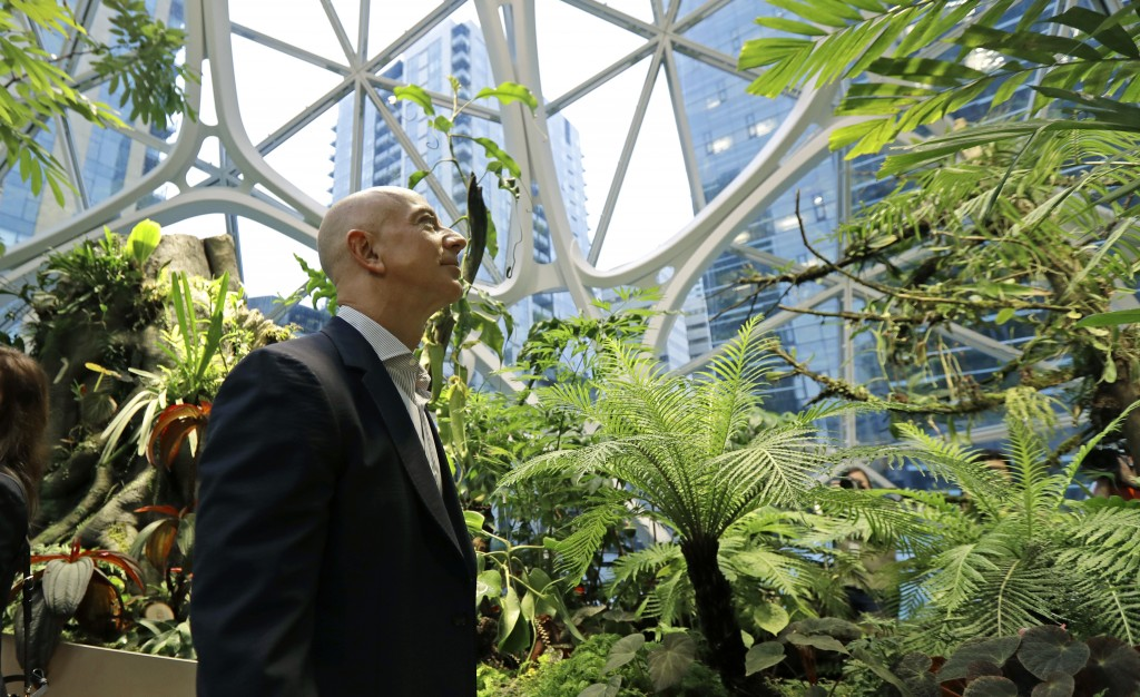 FILE- In this Jan. 29, 2018, file photo Jeff Bezos, the CEO and founder of Amazon.com, takes a walking tour of the Amazon Spheres in Seattle. Amazon h...
