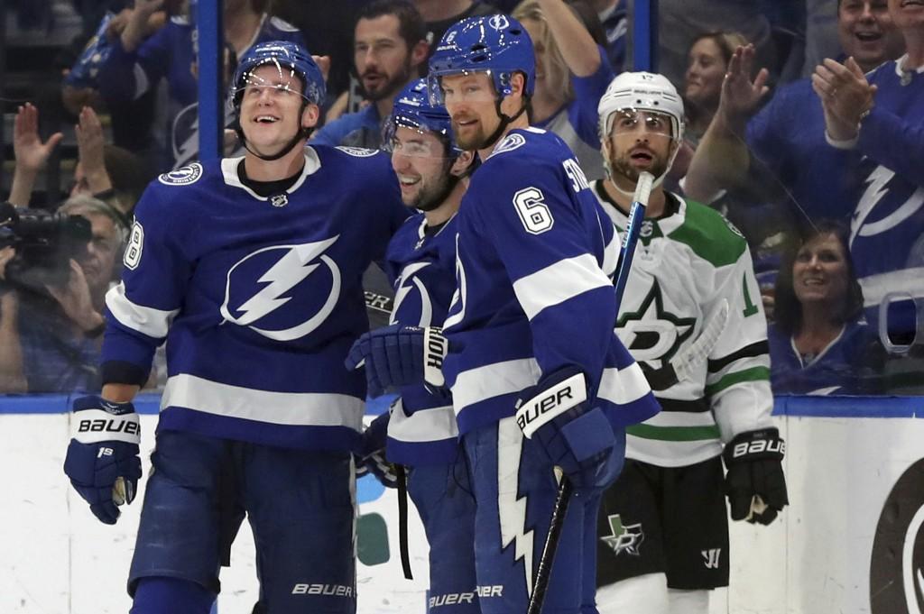 Tampa Bay Lightning's Ondrej Palat, of the Czech Republic, Tyler Johnson, and Anton Stralman, of Sweden, celebrate a goal as Dallas Stars' Andrew Cogl...