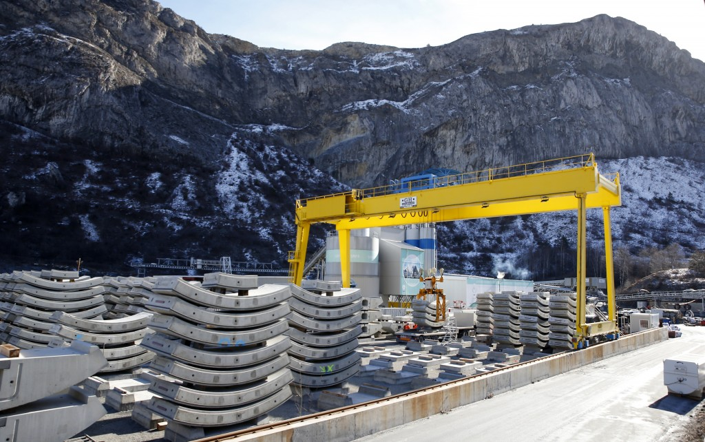 Parts of the a tunnel being built on the Turin-Lyon high-speed rail link (TAV) are piled up in Saint Martin La Porte, France, Tuesday, Feb. 12, 2019. ...