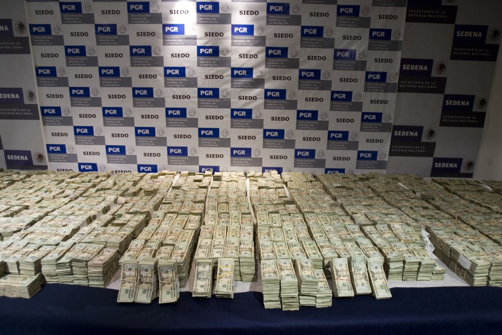 FILE - In this Sept. 18, 2008, file photo, cash seized by Mexico's Army, which according to the Defense Department was seized on Sept. 14 from the Sin...