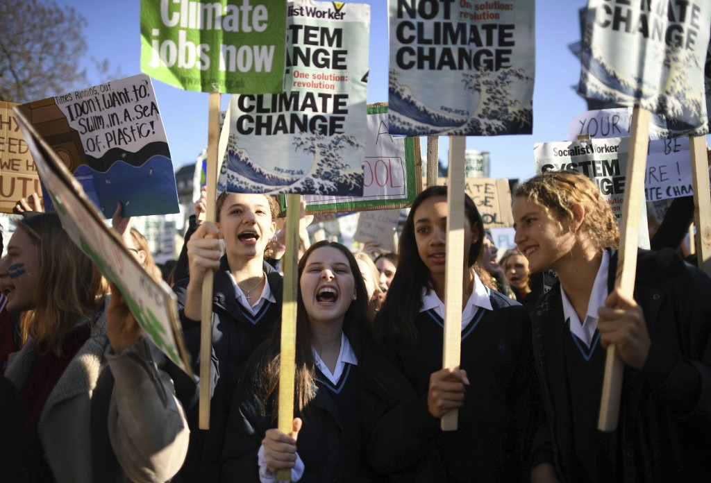 Students join the Youth Strike 4 Climate movement during a climate change protest near Parliament in London, Friday Feb. 15, 2019.  The demonstration ...