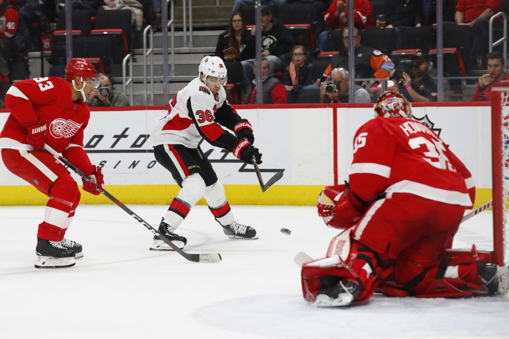 Ottawa Senators center Colin White (36) shoots on Detroit Red Wings goaltender Jimmy Howard (35) as Trevor Daley (83) defends in the first period of a...