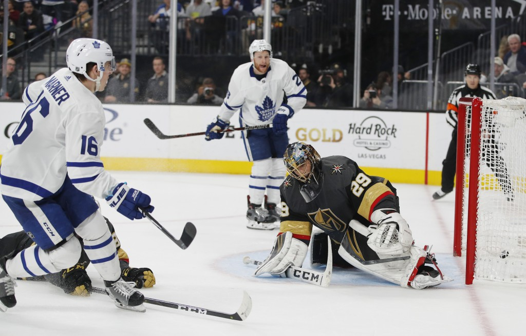 Toronto Maple Leafs right wing Mitchell Marner (16) scores against Vegas Golden Knights goaltender Marc-Andre Fleury (29) during the third period of a...