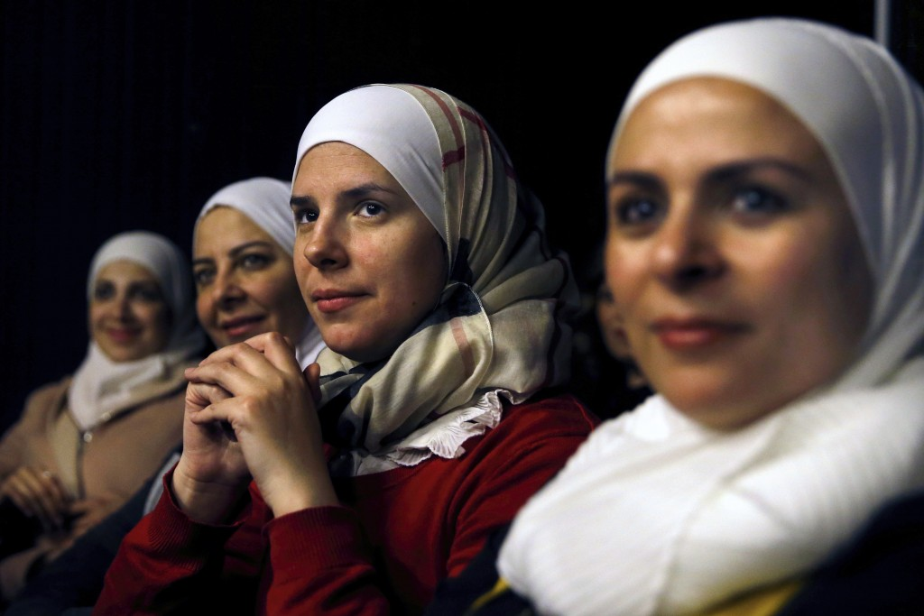 In this Friday, Feb. 8, 2019 photo, a group of Syrian women attend a playback theater at the end of a three-month training session, in Beirut, Lebanon...