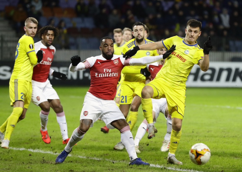 Arsenal's Alexandre Lacazette, front center, duels for the ball with Bate's Stanislav Dragun during the Europa League round of 32 first leg soccer mat...