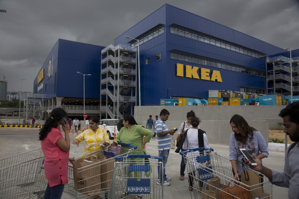 FILE- In this Aug. 9, 2018, file photo, Customers stand outside Ikea's first store in India as it opened in Hyderabad, India. India is a test case for...