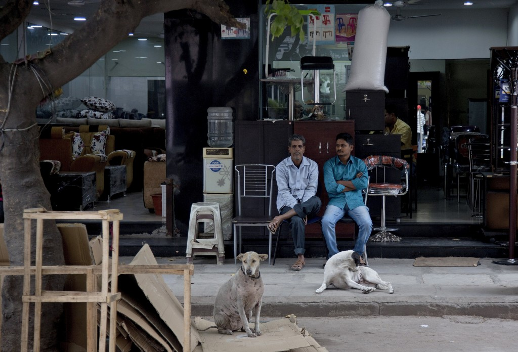 In this Dec. 17, 2018, photo, salesmen wait for customers at a shop at the Nampally furniture market in Hyderabad, India. This furniture market, where...