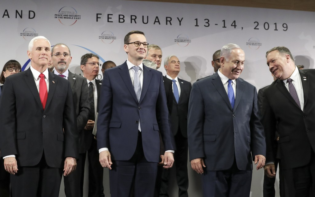 FILE - In this Thursday, Feb. 14, 2019 file photo, United States Vice President Mike Pence, Prime Minister of Poland Mateusz Morawiecki, Israeli Prime...