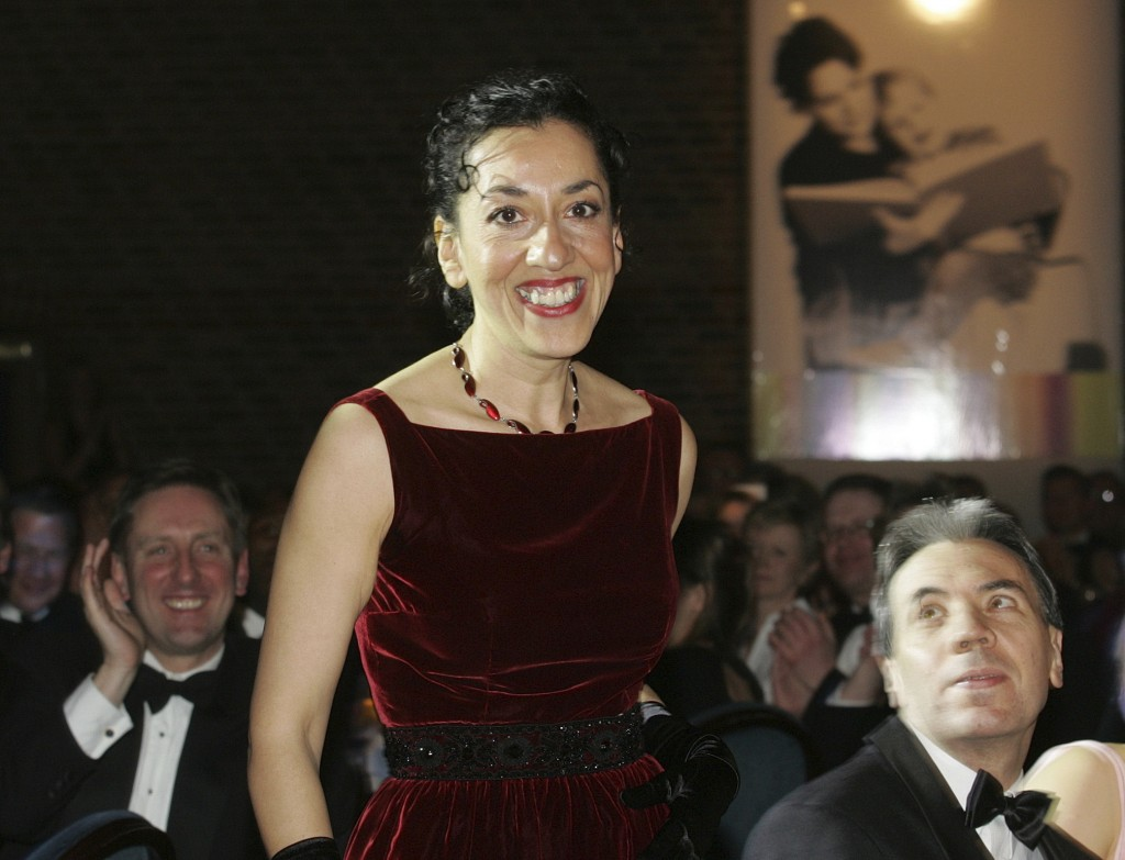 FILE  In this Tuesday, Jan. 25, 2005 file photo, Andrea Levy, winner of the 2005 Whitbread Book Prize for her novel 'Small Island' reacts following th...