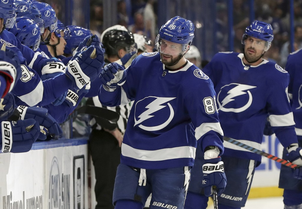 Tampa Bay Lightning's Nikita Kucherov, of Russia, is congratulated for a goal against the Dallas Stars during the first period of an NHL hockey game T...