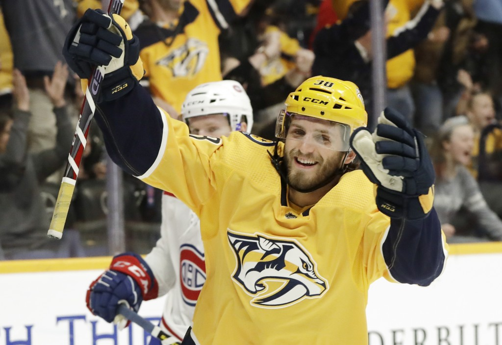 Nashville Predators right wing Ryan Hartman (38) celebrates after scoring a goal against the Montreal Canadiens in the second period of an NHL hockey ...