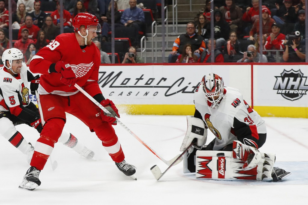 Ottawa Senators goaltender Anders Nilsson (31) stops a Detroit Red Wings right wing Anthony Mantha (39) shot in the second period of an NHL hockey gam...