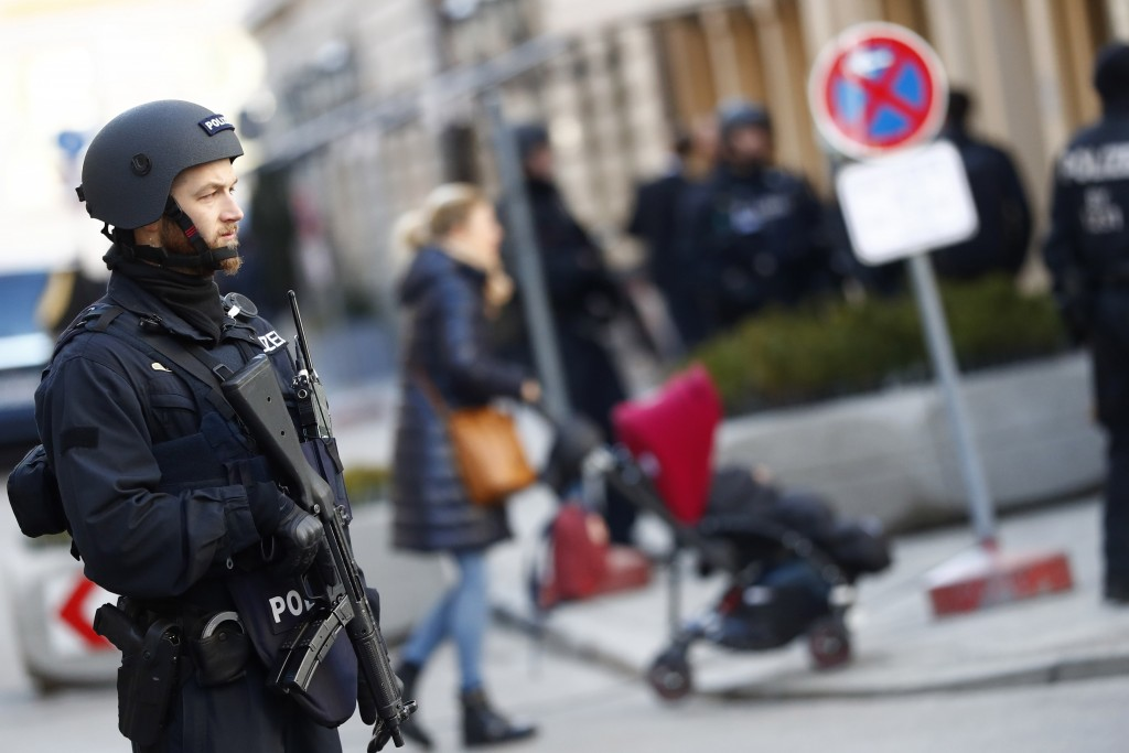 A police officer secures the area around the Hotel 'Bayerischer Hof' at the first day of the International Security Conference in Munich, Germany, Fri...
