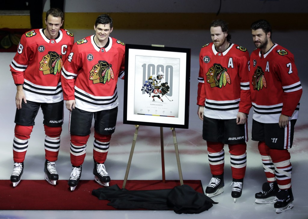Chicago Blackhawks' Chris Kunitz, second from left, Jonathan Toews, left, Duncan Keith, second from right, and Brent Seabrook pose for photos before a...