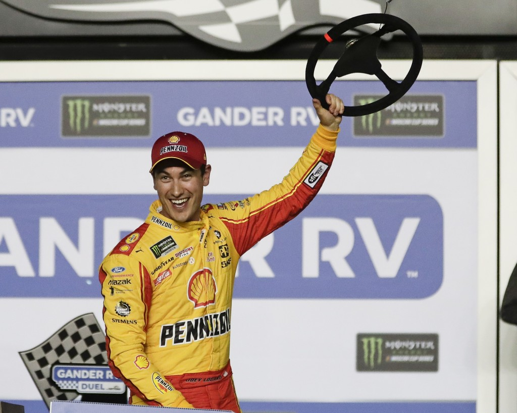 Joey Logano celebrates in Victory Lane after winning the second of two qualifying auto races for the NASCAR Daytona 500 at Daytona International Speed...