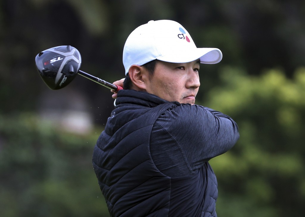 Sung Kang watches his drive on the second tee during the first round of the Genesis Open golf tournament at Riviera Country Club in the Pacific Palisa...