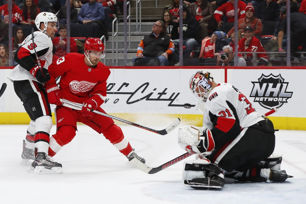 Ottawa Senators goaltender Anders Nilsson (31) stops a Detroit Red Wings left wing Darren Helm (43) shot as Bobby Ryan (9) defends in the second perio...