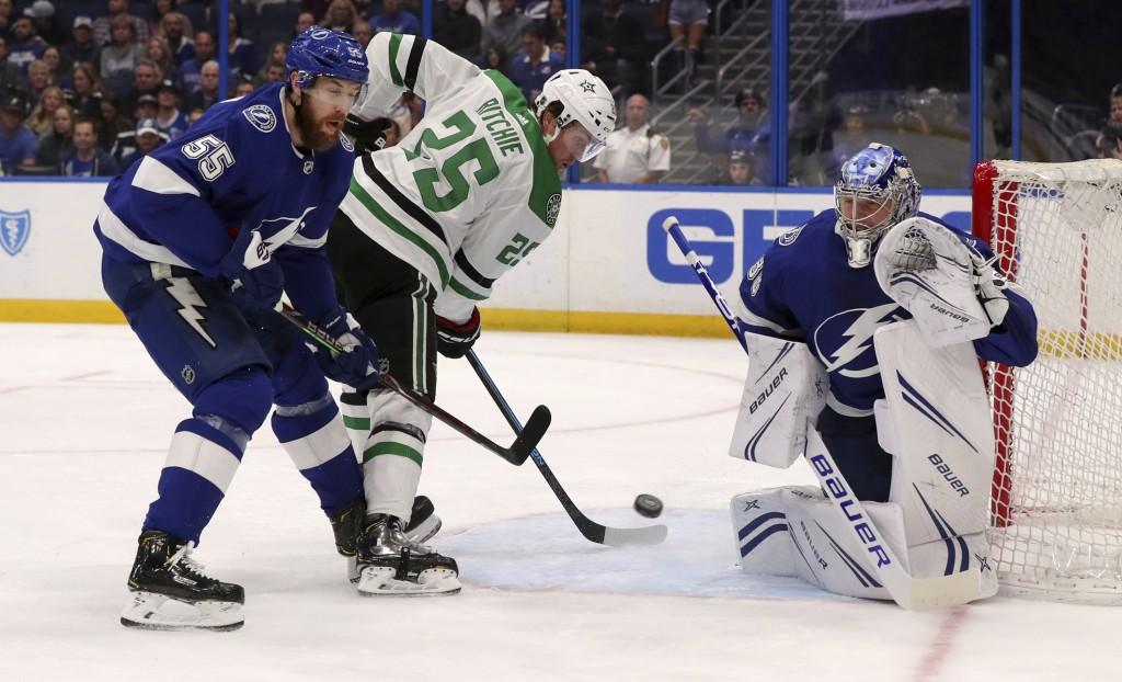 Tampa Bay Lightning goaltender Andrei Vasilevskiy, of Russia, makes a save against Dallas Stars' Brett Ritchie, as Braydon Coburn (55) defends during ...
