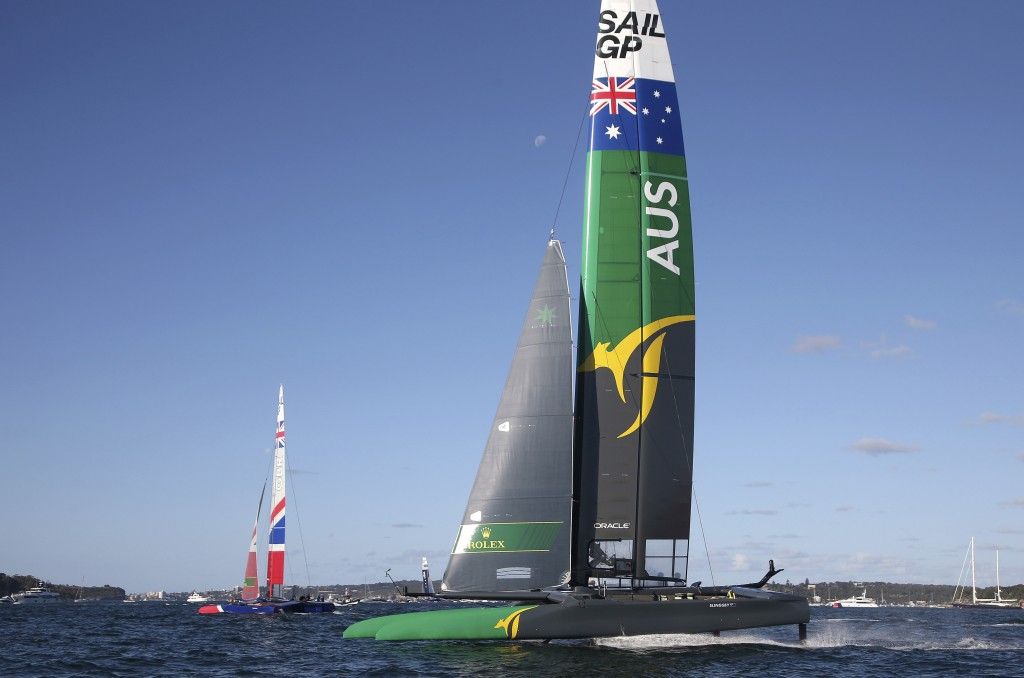 Team Australia, right, and Team Britain race their F50 catamarans during their SailGP race on the harbor in Sydney, Friday, Feb. 15, 2019. Six super-c...