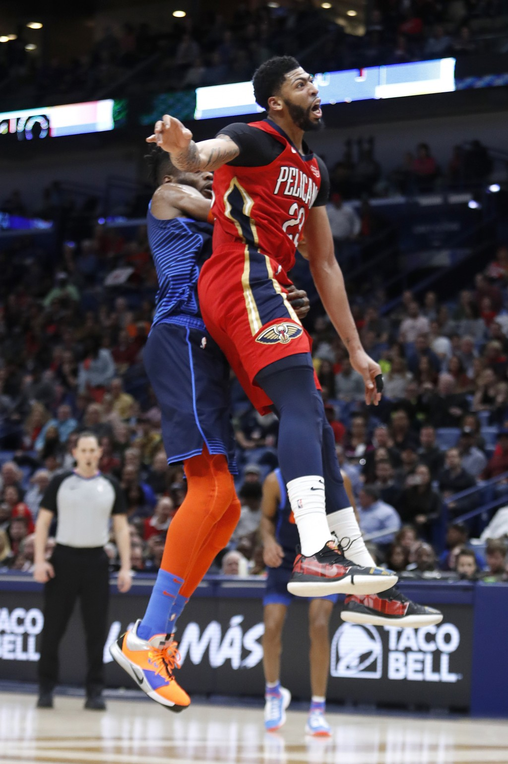 New Orleans Pelicans forward Anthony Davis (23) collides with Oklahoma City Thunder forward Nerlens Noel (3) after attempting to block a shot at the e...