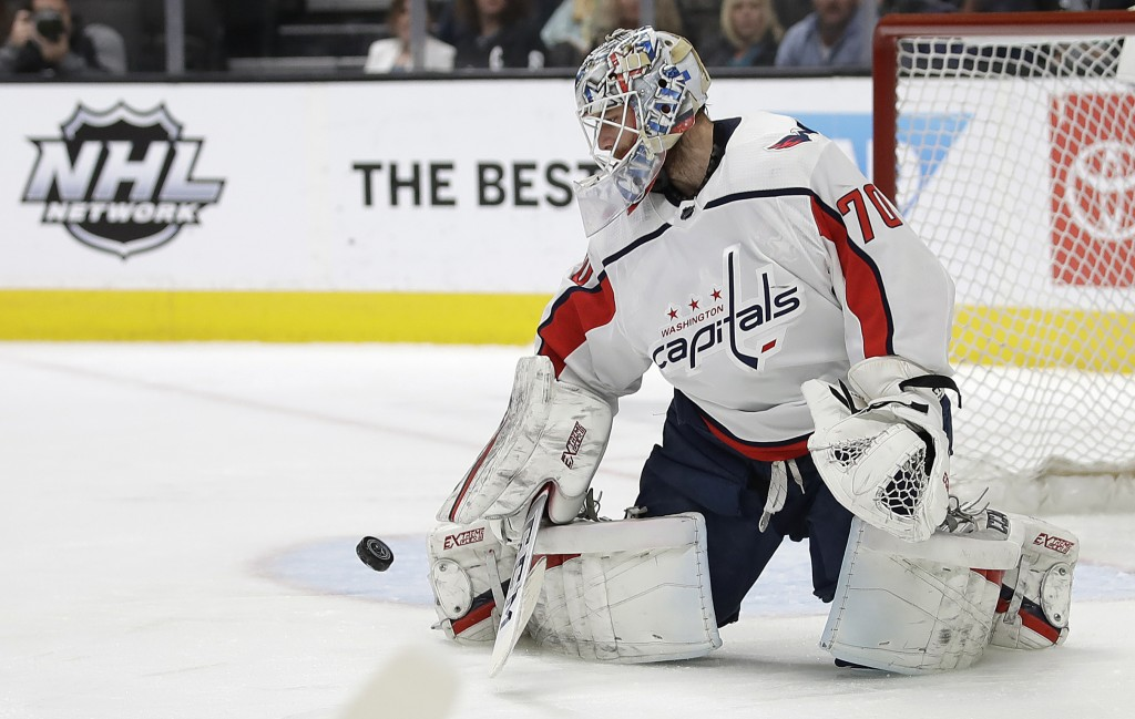 Washington Capitals goalie Braden Holtby blocks a shot from the San Jose Sharks in the first period of an NHL hockey game Thursday, Feb. 14, 2019, in ...