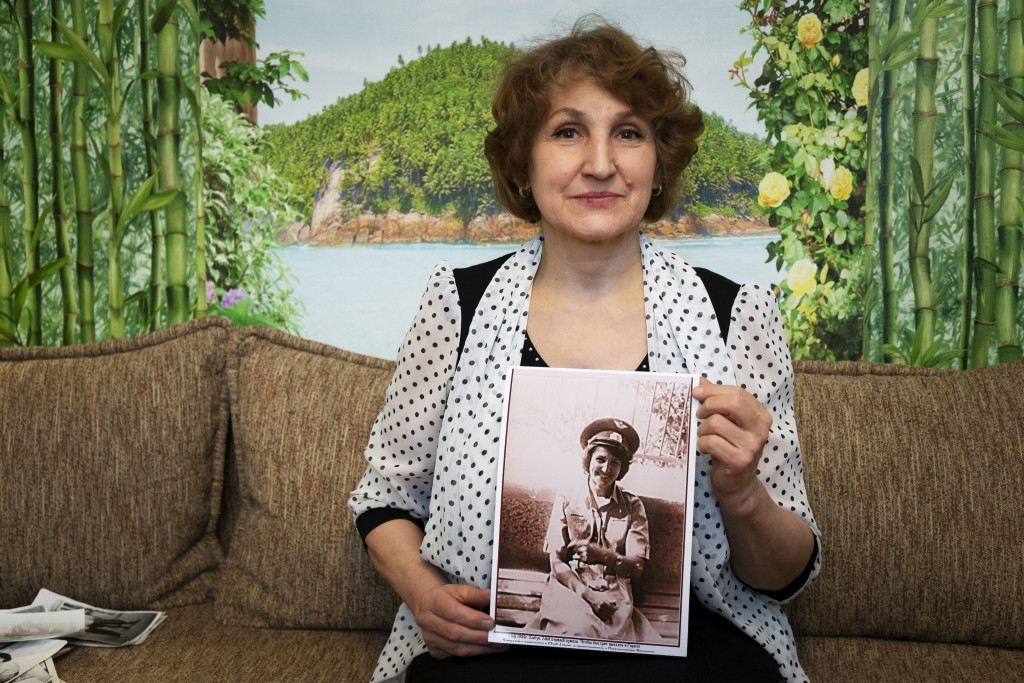 In this photo taken on Sunday, Feb. 10, 2019, Tatyana Rybalchenko, who worked as a nurse during the Soviet campaign in Afghanistan between 1986 and 19...