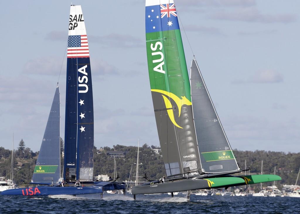 The Australian team, right, races their F50 catamaran ahead of the USA team during their SailGP race on the harbor in Sydney, Friday, Feb. 15, 2019. S...