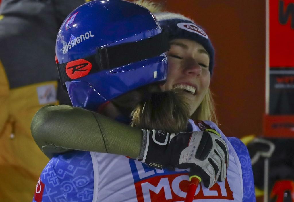 United States' Mikaela Shiffrin congratulates Slovakia's Petra Vlhova in the finish area of the women's giant slalom, at the alpine ski World Champion...
