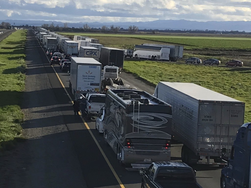This Feb. 14, 2019, photo released by Caltrans District 3 shows a 7-mile back up on the South bound Interstate 5, as it reopens to traffic in Maxwell ...