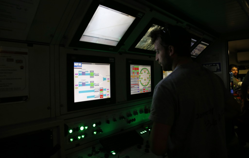 """An engineer works in a pilot cabin of a 140-meter-long rock-eating machine dubbed """"Federica"""" in a Turin-Lyon high-speed rail tunnel (TAV) in Saint Mar..."""