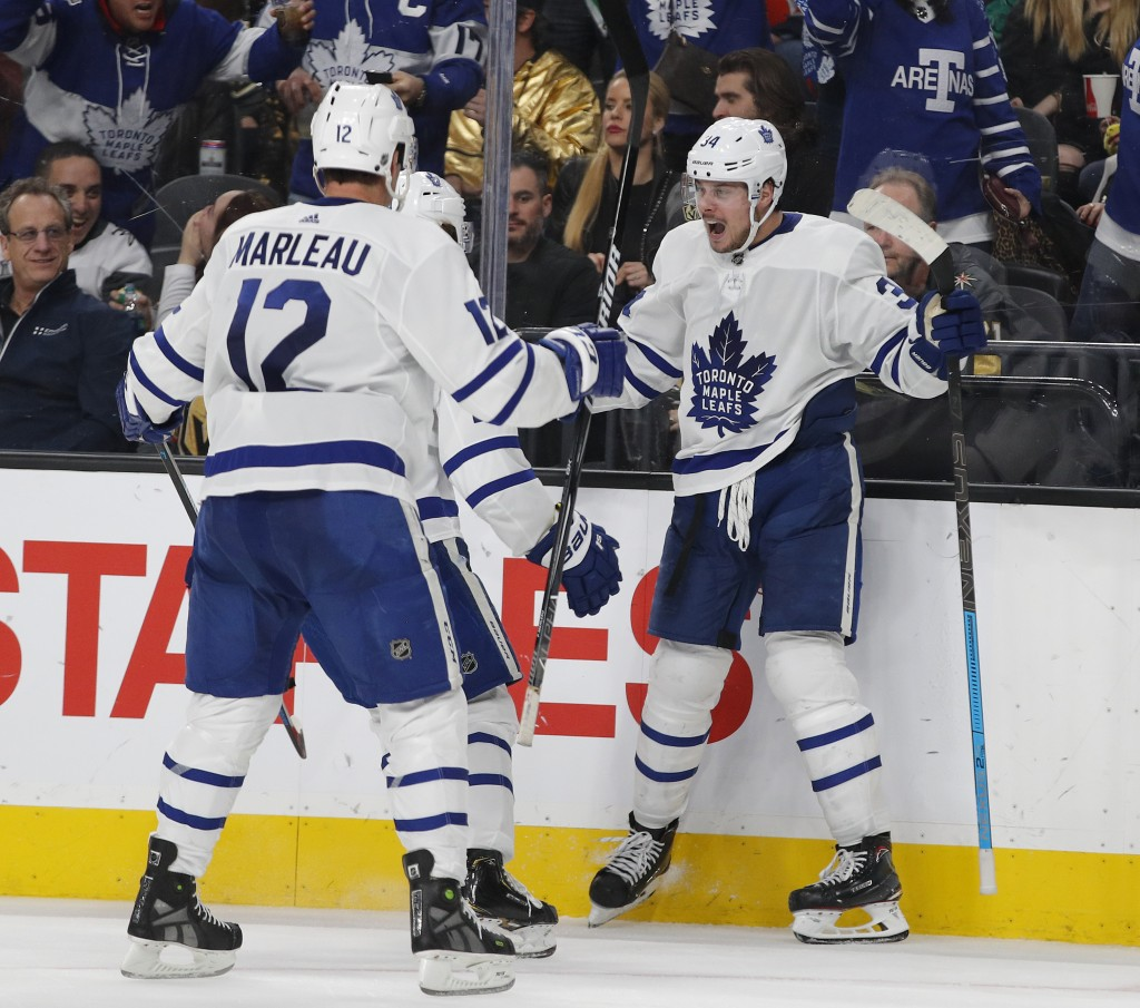 Toronto Maple Leafs center Auston Matthews, right, celebrates after scoring against the Vegas Golden Knights during the third period of an NHL hockey ...