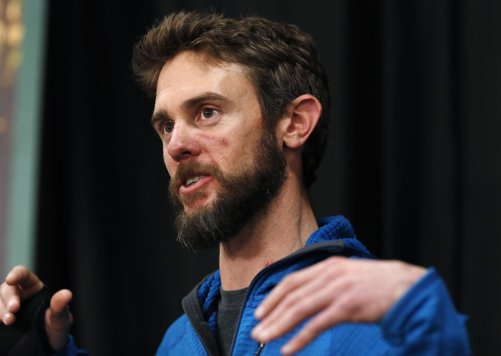 Travis Kauffman responds to questions during a news conference Thursday, Feb. 14, 2019, in Fort Collins, Colo., about his encounter with a mountain li