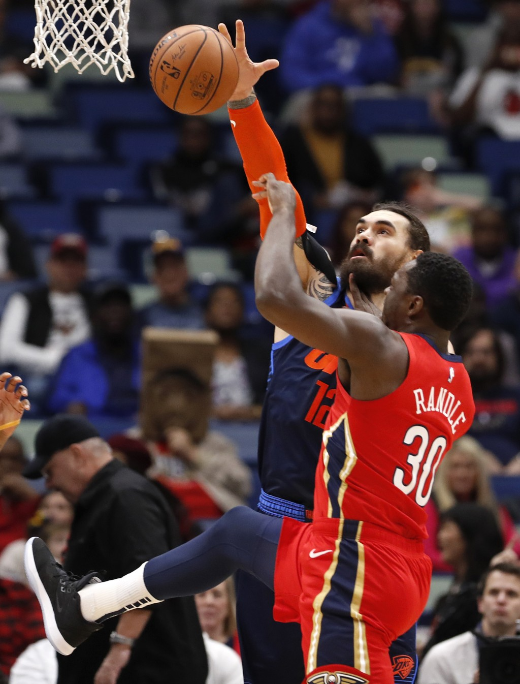 Oklahoma City Thunder center Steven Adams (12) blocks a shot from New Orleans Pelicans center Julius Randle (30) during the first half of an NBA baske...
