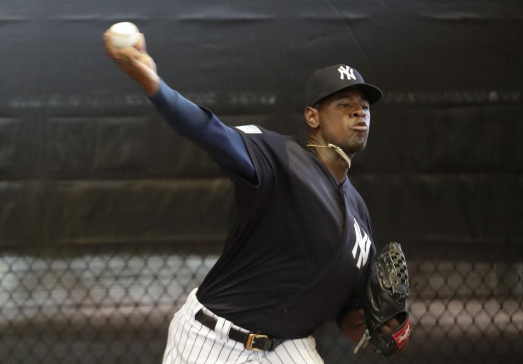 New York Yankees starting pitcher Luis Severino throws in the bullpen at the team's spring training baseball facility, Thursday, Feb. 14, 2019, in Tam...