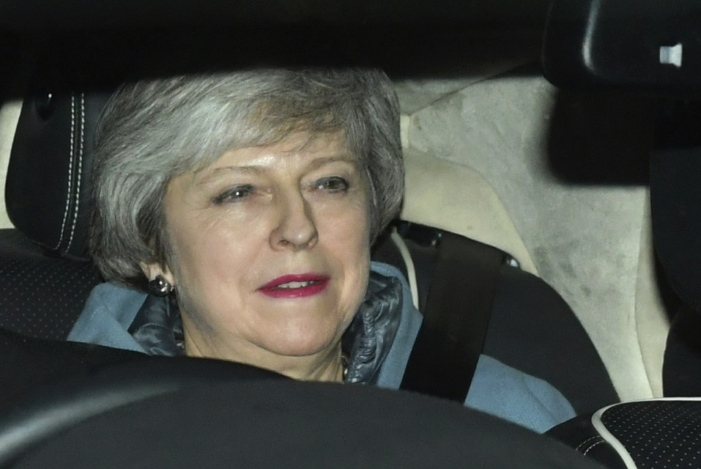 Britain's Prime Minister Theresa May leaves the Houses of Parliament in Westminster following a Brexit vote in the House of Commons, in London, Thursd...