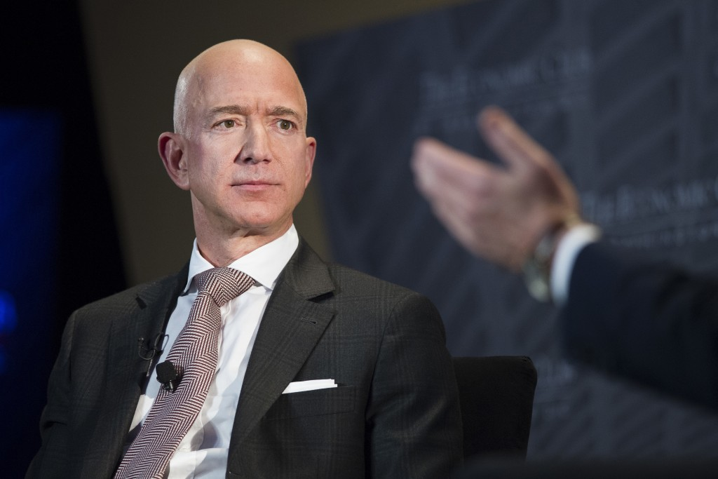 FILE - In this Sept. 13, 2018, file photo Jeff Bezos, Amazon founder and CEO, speaks at The Economic Club of Washington's Milestone Celebration in Was...