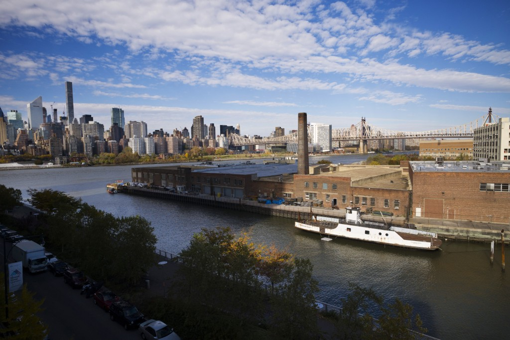 FILE- In this Nov. 7, 2018, file photo, a rusting ferryboat is docked next to an aging industrial warehouse on Long Island City's Anable Basin in the ...