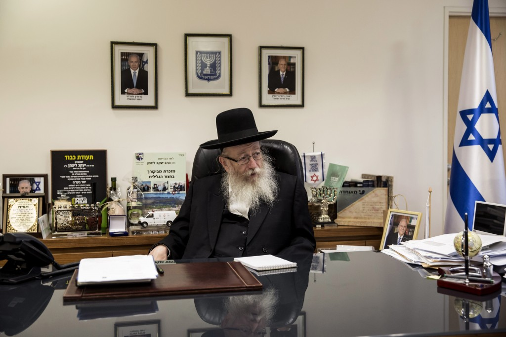 FILE - In this Wednesday, Sept. 7, 2016 file photo, Israeli Health Minister Yaakov Litzman speaks during an interview with the Associated Press in Jer...