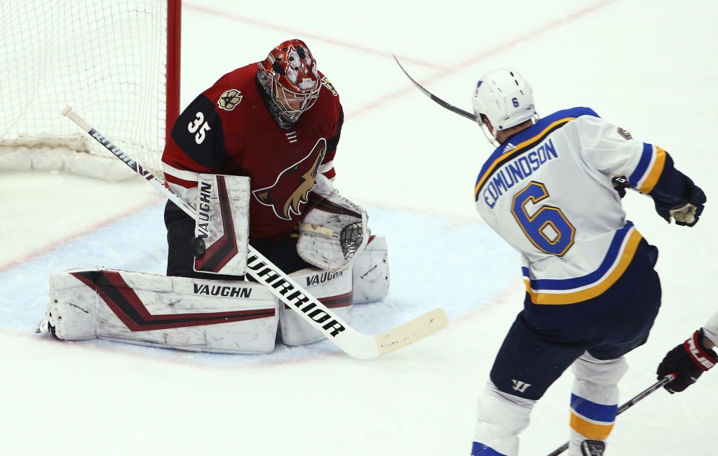 St. Louis Blues defenseman Joel Edmundson (6) sends the puck past Arizona Coyotes goaltender Darcy Kuemper (35) for a goal during the first period of ...